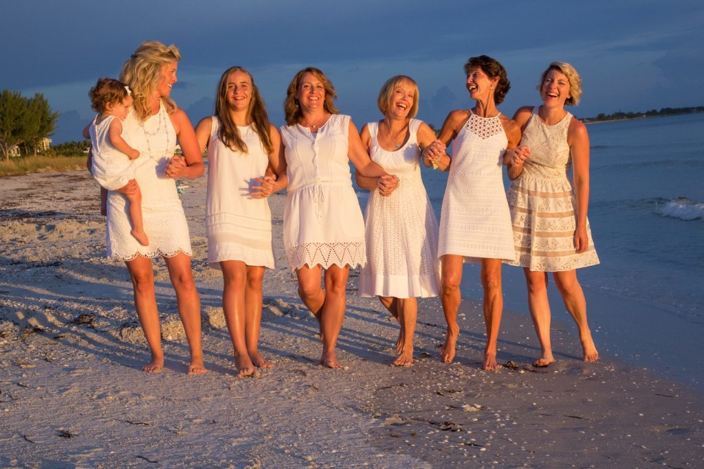 Ladies in white dresses having fun at the beach