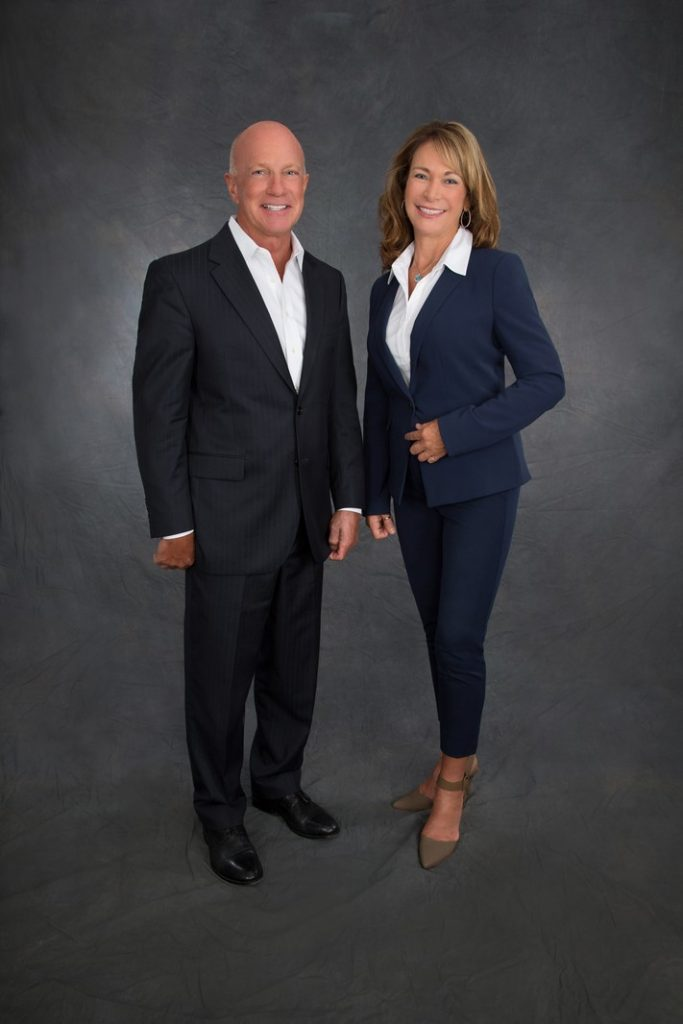 Team Studio Portrait - Man and Woman Wearing Business Suits