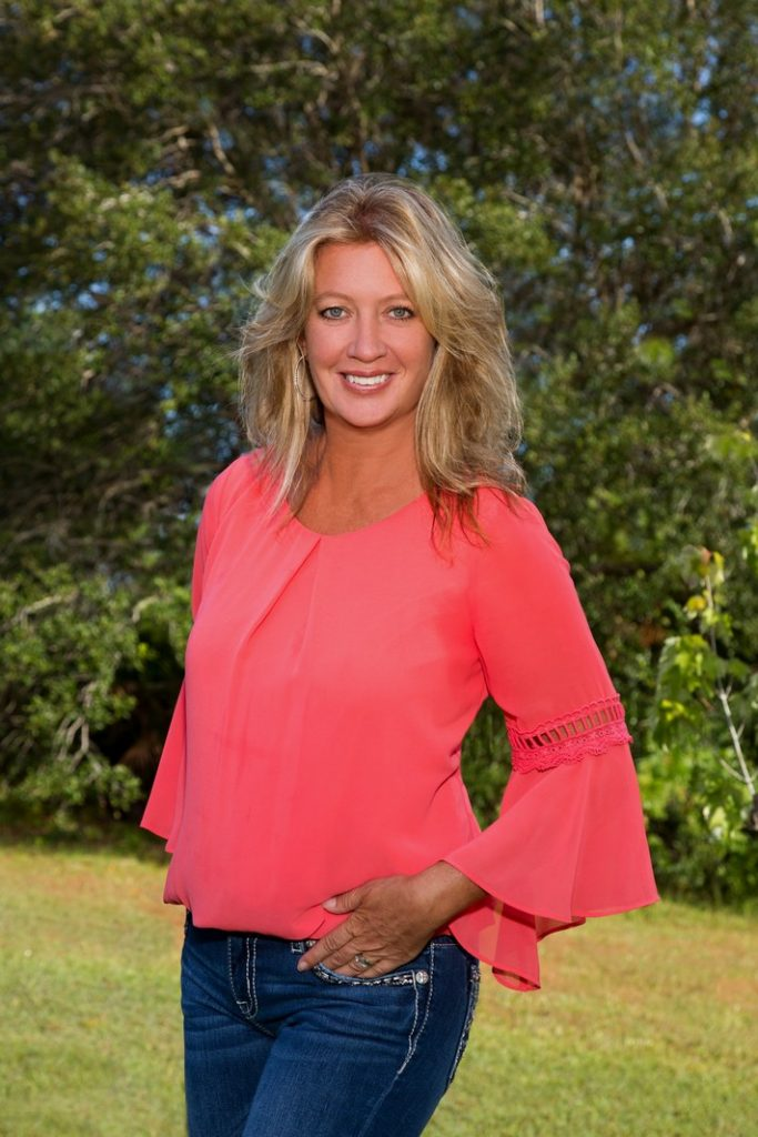 Casual Outdoor Realtor Portrait of Woman in Pink Shirt