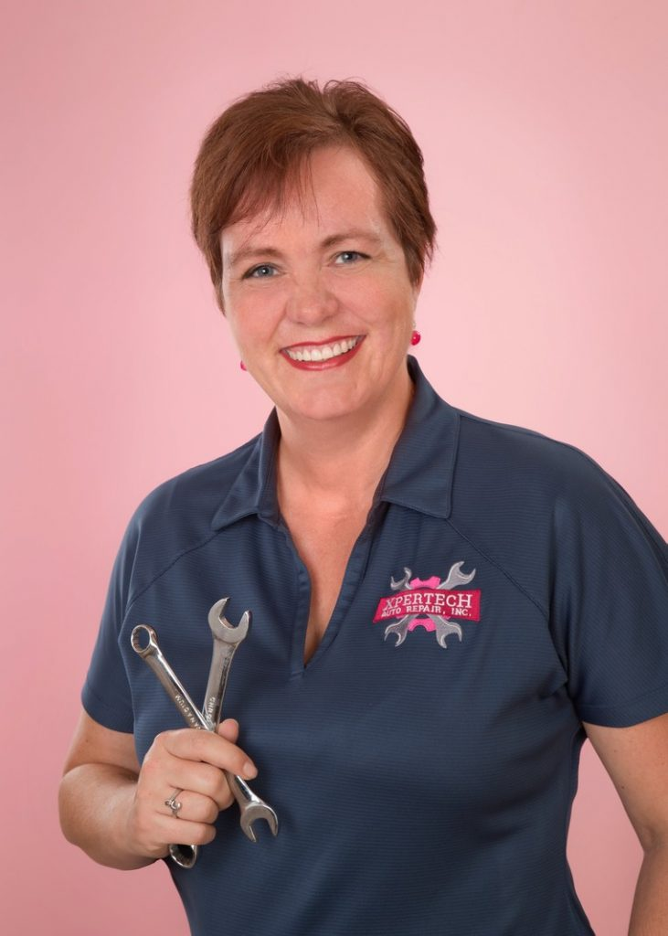 Business Portrait of a Woman holding tools