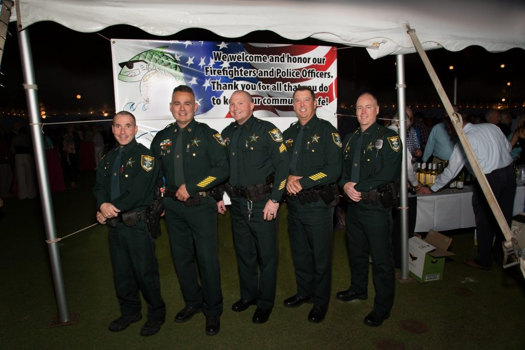 Police Officer Group Photo at Participating Restaurant at the Taste of Boca Grande Event