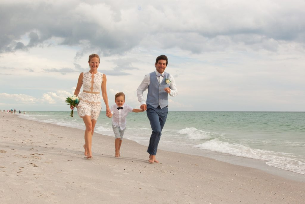 Bride and Groom with their son at the beach