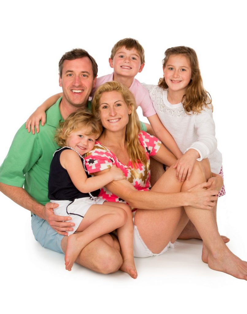 Family of five photographed in the studio on a white backdrop